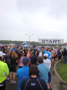 At the start, in a drizzle, freezing cold, although a number of people are dressed in shorts.