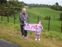 A little girl supporting her mom all the way as dad drove the car further up the road every few kilometres.