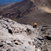 Gerry, almost at the top of Mt Ngauruhoe with Mt Tongariro in the back.
