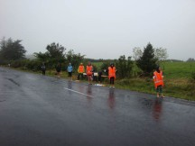 The poor marshals at the water tables, soaking wet.