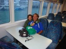 Nervous smiles on the ferry heading to Motutapu.