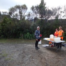 Gerry enjoying the hospitality of some very friendly volunteers at the water point/aid station.