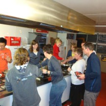 In the backpackers kitchen, whipping up lovely dinners.