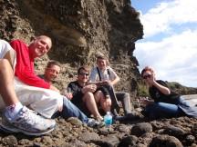 Gerry, me, Willie, Alida's dad Esra, and Alida at Piha beach, enjoying a bubbly.