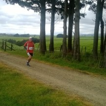 Almost there - running along the farm track just before the last long downhill towards the finish.