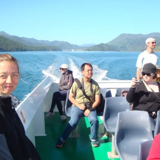 On our way, enjoying lovely views of the hills and islands in the sounds, from the top of the taxi.