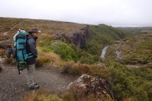 On top of Taranaki Falls. Other trampers and day visitors can be spotted way below.