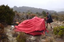 Pitching the tent in wind is no easy feat.