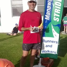 Gerry with post-run banana and sausage sizzle - another happy Manawatu Striders customer.