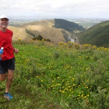 Gerry speeding by in a blur with the Manawatu Gorge and River below.