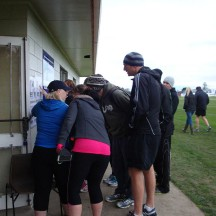 Runners huddled around the course maps.