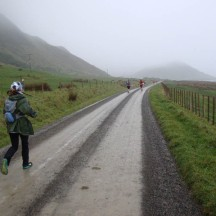 Runners disappearing into the mist.