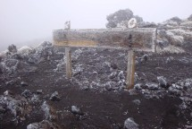 An old wooden sign-post halfway up the mountain adding atmosphere to the walk.