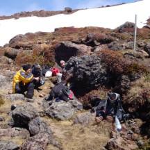 Quick lunch break, huddling between some rocks for shelter.
