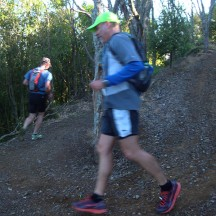 Gerry speeding around the switchbacks on an early steep downhill.