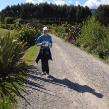 Crossing the narrow road leading to the island in the lake and Whakamaru Christian Camp, finishing site of the race.