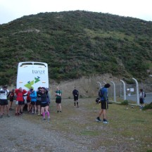 Runners huddled up behind the bus.