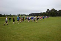 The field of runners rounding the Ashhurst Domain oval.
