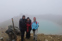 Mist starting to clear a little to give us a lovely view of Emerald Lakes. [Photo: J&N]