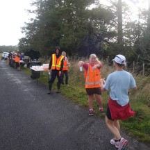 Friendly volunteer helpers at the well stocked aid stations.