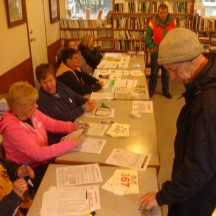 Friendly helpers at the registration desk.