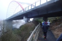 Passing underneath the SH1 bridge. We've driven over the bridge many times, never expecting to be running under it!