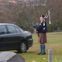 The bagpipe player is a feature we remembered from our previous running of the Taupo Half Marathon.