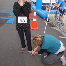 Always eternally grateful for volunteers helping to remove timing chips at the finish.