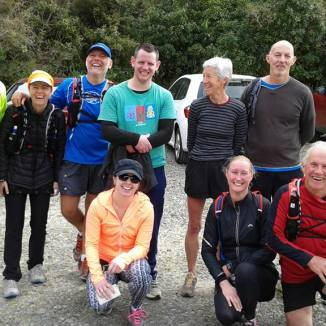 Having a laugh at the finish, l-to-r: Kevin, Wouna, Gerry, Greg, Marian, Peter, Cath and in front Steph, Cheryl and Rob. Photo supplied by Cheryl, and taken by the late Stuart Hilder. The four walkers (Bruce, Evan, Denise and David) were having lunch already.