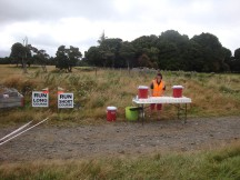 An awkwardly placed water station. First you veer off to the left, missing the table (my thoughts were that the water point was maybe meant for the 15km guys?) and when you pass it again from the other side, you turn away towards the right before reaching the table, missing it again.