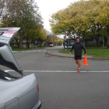 Rob collecting cones afterwards, still with a spring in his step after 42kms.