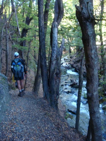 Following the Fern Burn river up the shadowy valley.