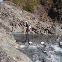 Crossing the icy stream near the top of the Cascades.