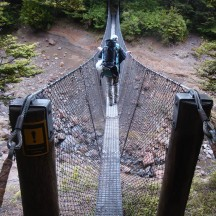 The first of a number of one-person swing bridges, crossing high above the stream.