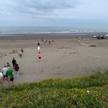 Participants making their way to the start on the beach.