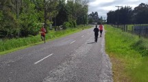 The half marathon winner, Edward Currie, speeding past on his way to victory.