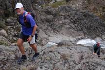 Gerry climbing up the rock face.