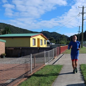 If the run didn't lift his spirits, this bright and jovial yellow house certainly did.