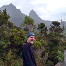 Wet, wet, wet. One of the last sightings of Cradle Mountain (1545m) on the left, before it was clouded over. Barn Bluff is the peak on the right (1559m).