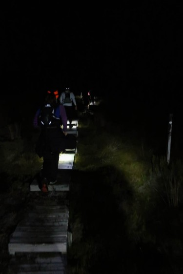 Following the wooden track by the light of our headlamps.