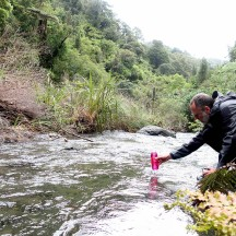 Fetching water from the stream about 60 metres from the hut.