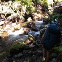 Another tricky river crossing. Here Gerry's foot slipped off a rock, so it was wet feet again.