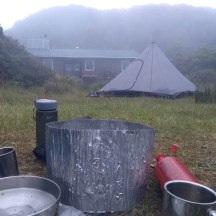 Cooking outside on a misty evening.
