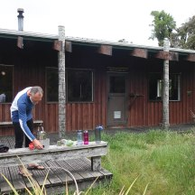 Opting to cook and spend the evening outside at Waingongoro Hut.