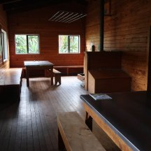 A huge common room inside the hut.