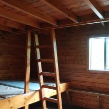Two layers of bunks in each of the two rooms.
