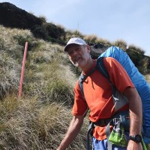 The sturdy tussock grass is a lifesaver to hang on to as you make your way down the steepest sections.