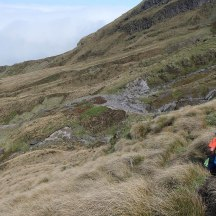 Walking high was a mix of tussock and rocky, eroded valleys.