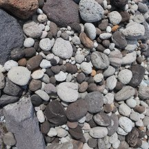 Volcanic rocks of all different colours creating a beautiful display.