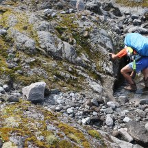 Filling our water bottles from the mountain stream (above the dead bird, luckily).